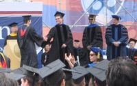 Ryan Goldstein on stage with Eric Schmidt, CEO of Google, at the 2009 Penn Engineering graduation